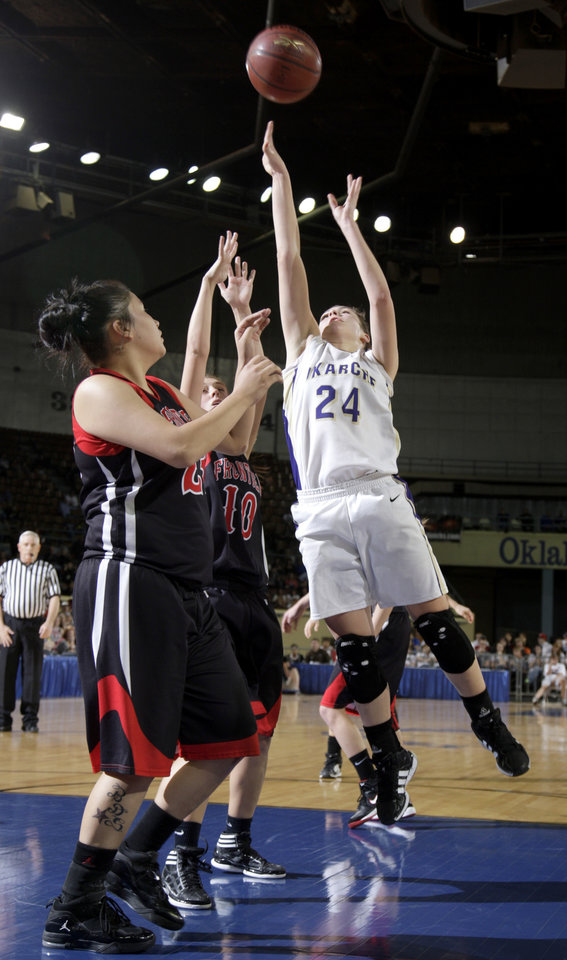 Photo - Okarche's Madison Lee shoots as Frontier's Brandee Sigwing (23) and Tiffany Young (10) defend during Class A girls state championship high school basketball game between Okarche and Frontier  at the State Fair Arena in Oklahoma City,  Saturday, March 3, 2012. Photo by Sarah Phipps, The Oklahoman