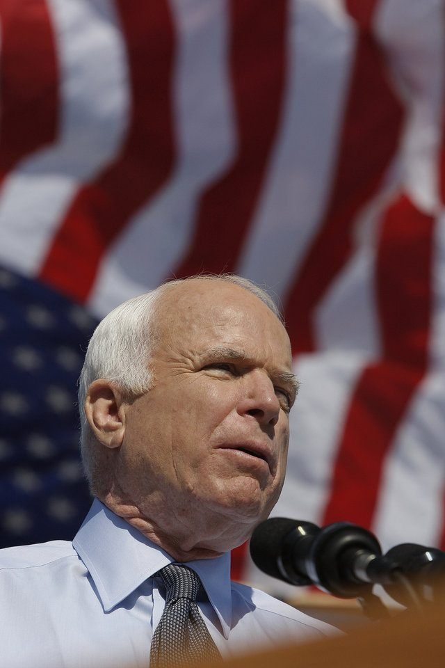 Photo - Republican presidential candidate Sen. John McCain, R-Ariz. addresses supporters during a campaign rally in Miami, Fla., Wednesday, Oct. 29, 2008. (AP Photo/Stephan Savoia) ORG XMIT: FLSS106