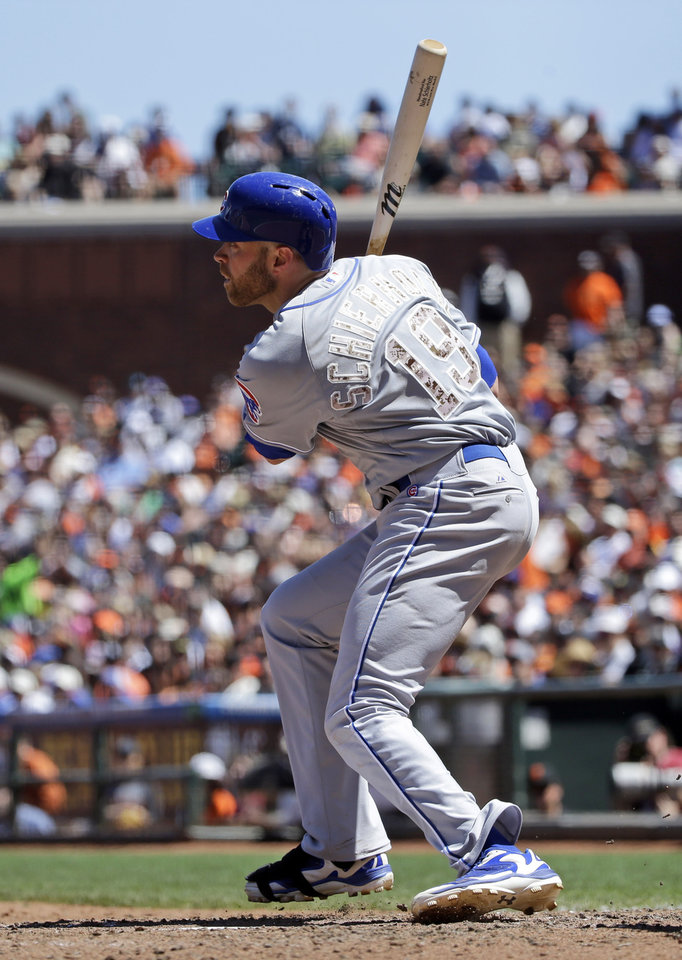 Photo - Chicago Cubs' Nate Schierholtz (19) singles against the San Francisco Giants during the sixth inning of a baseball game on Monday, May 26, 2014, in San Francisco. (AP Photo/Marcio Jose Sanchez)