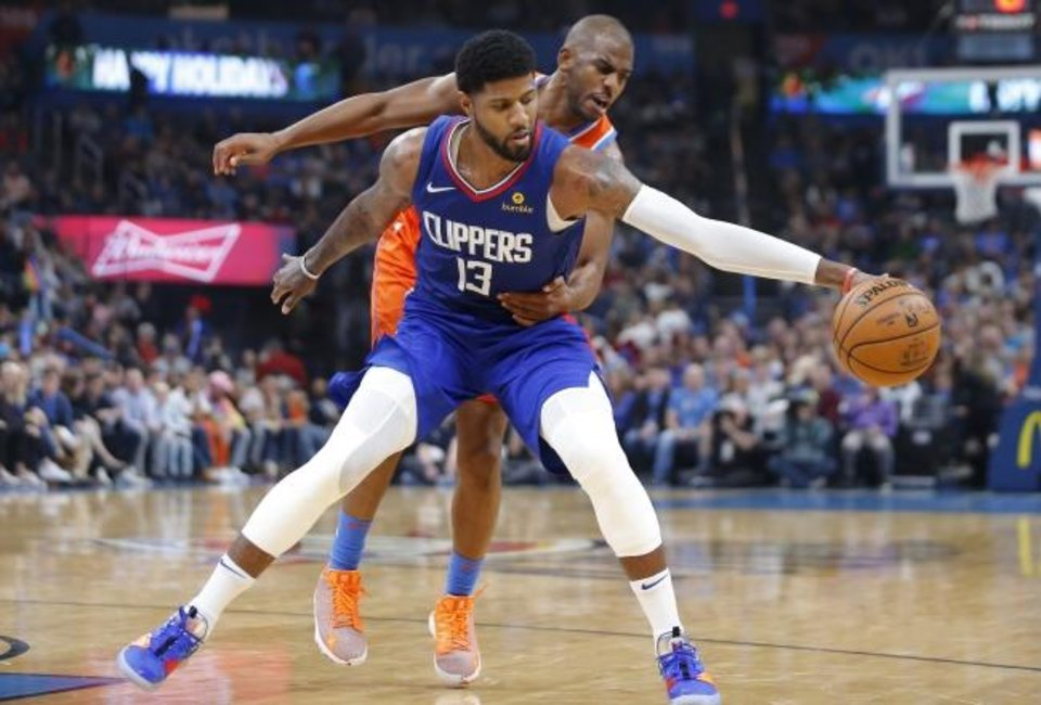 Photo -  Oklahoma City's Chris Paul (3) defends LA's Paul George (13) during Sunday night's game at Chesapeake Energy Arena in Oklahoma City. Oklahoma City won 118-112 in George's return to OKC as a Clipper . [Bryan Terry/The Oklahoman]