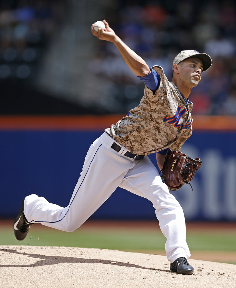 Photo - New York Mets starting pitcher Carlos Torres delivers in the first inning of a baseball game against the Chicago Cubs at Citi Field in New York, Monday, Aug. 18, 2014. (AP Photo/Kathy Willens)