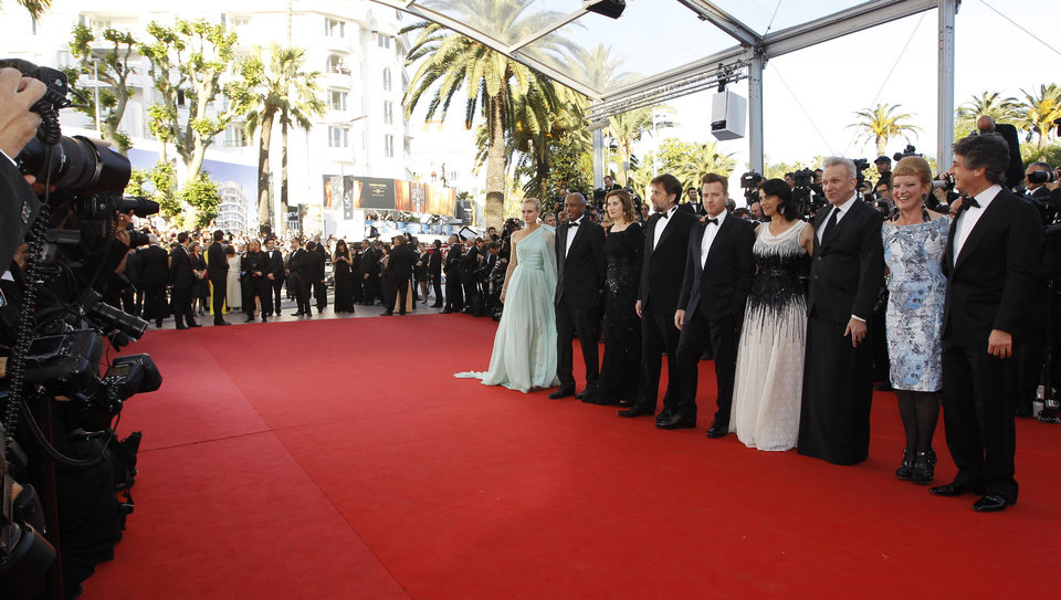 Photo - From left, members of the jury, Diane Kruger, Raoul Peck, Emmanuelle Devos, Nanni Moretti, Ewan McGregor, Hiam Abbass, Jean-Paul Gaultier, Andrea Arnold, Alexander Payne arrive for the opening ceremony and screening of Moonrise Kingdom at the 65th international film festival, in Cannes, southern France, Wednesday, May 16, 2012. (AP Photo/Joel Ryan) ORG XMIT: CAN190