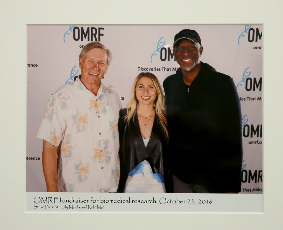 Photo -  This is a photo of Dr. Stephen Prescott with Lily Meola and Keb' Mo' during an OMRF fundraiser. [PHOTO PROVIDED]