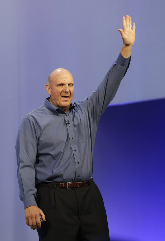 Photo - FILE - This June 26, 2013, file photo, shows Microsoft CEO Steve Ballmer waving after speaking at a Microsoft event in San Francisco. Ballmer is officially the new owner of the Los Angeles Clippers. The team says the sale closed Tuesday, Aug. 12, 2014,  after a California court confirmed the authority of Shelly Sterling, on behalf of the Sterling Family Trust, to sell the franchise.  (AP Photo/Jeff Chiu, File)