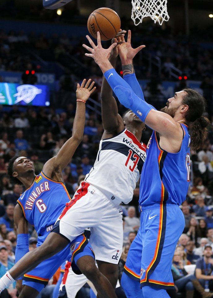 Photo - Oklahoma City's Steven Adams (12), right, tries to grab a rebound against Washington's Thomas Bryant (13) next to Oklahoma City's Hamidou Diallo (6) in the second quarter during an NBA basketball game between the Oklahoma City Thunder and the Washington Wizards at Chesapeake Energy Arena in Oklahoma City, Friday, Oct. 25, 2019. [Nate Billings/The Oklahoman]