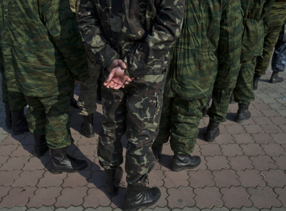 Photo - Members of the new Crimean army attend a morning briefing in Lenin Square, in Simferopol, Ukraine, Saturday, March 15, 2014. Tensions are high in the Black Sea peninsula of Crimea, where a referendum is to be held Sunday on whether to split off from Ukraine and seek annexation by Russia. (AP Photo/Vadim Ghirda)
