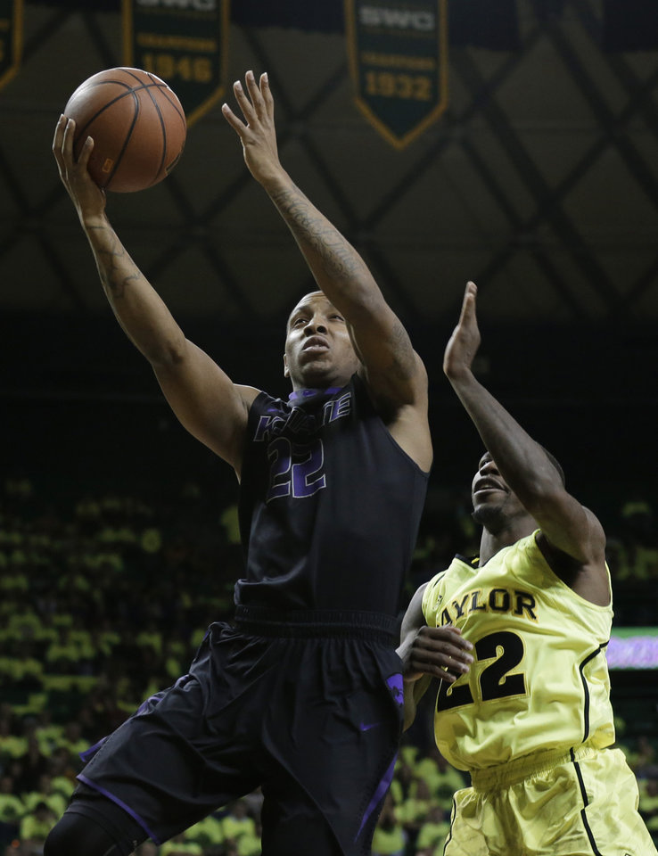 Kansas State's Rodney McGruder, left, goes up for a score after getting by Baylor's A.J. Walton, right, in the first half of an NCAA college basketball game on Saturday, March 2, 2013, in Waco, Texas. (AP Photo/Tony Gutierrez)
