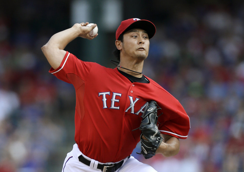 Texas Rangers starting pitcher Yu Darvish (11) of Japan works against the Houston Astros in the first inning of a baseball game Saturday, July 6, 2013, in Arlington, Texas. (AP Photo/Tony Gutierrez)