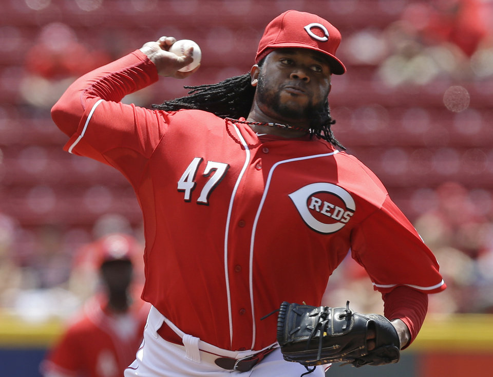 Photo - Cincinnati Reds starting pitcher Johnny Cueto throws against the Chicago Cubs in the first inning of a baseball game, Tuesday, July 8, 2014, in Cincinnati. (AP Photo/Al Behrman)