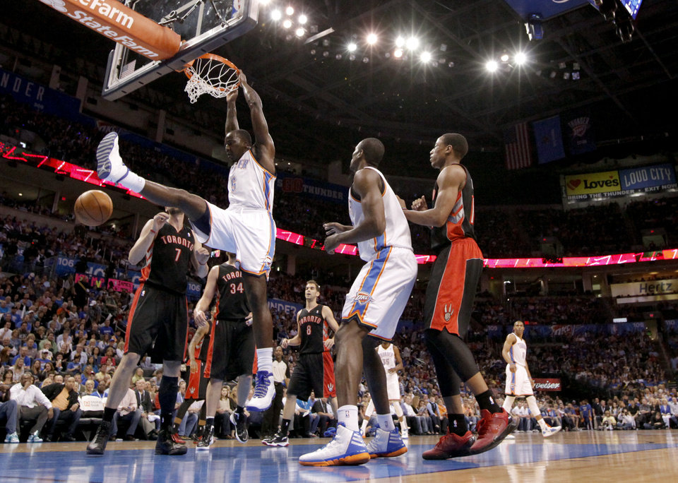 Oklahoma City\'s Kendrick Perkins (5) dunks that ball during the NBA basketball game between the Oklahoma City Thunder and the Toronto Raptors at Chesapeake Energy Arena in Oklahoma City, Sunday, April 8, 2012. Photo by Sarah Phipps, The Oklahoman.