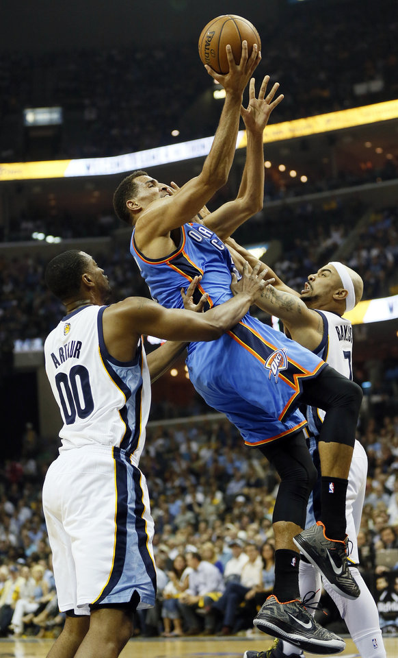 Photo - Oklahoma City's Thabo Sefolosha (2) is fouled by Memphis' Jerryd Bayless (7) as he tries to take the ball past Darrell Arthur (00) in the first half during Game 4 of the second-round NBA basketball playoff series between the Oklahoma City Thunder and the Memphis Grizzlies at FedExForum in Memphis, Tenn., Monday, May 13, 2013. Photo by Nate Billings, The Oklahoman