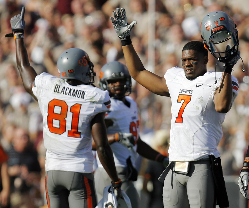 Oklahoma State's Michael Harrison (7) and Justin Blackmon (81) celebrate after an official's review changed a call of an incomplete pass into a touchdown catch by Blackmon in the third quarter Saturday. Photo by Nate Billings, The Oklahoman