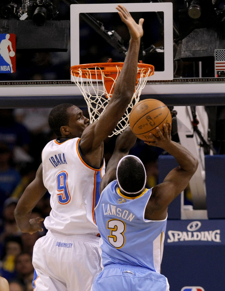 Oklahoma City\'s Serge Ibaka (9) defends Denver\'s Ty Lawson (3) during the first round NBA playoff game between the Oklahoma City Thunder and the Denver Nuggets on Sunday, April 17, 2011, in Oklahoma City, Okla. Photo by Chris Landsberger, The Oklahoman