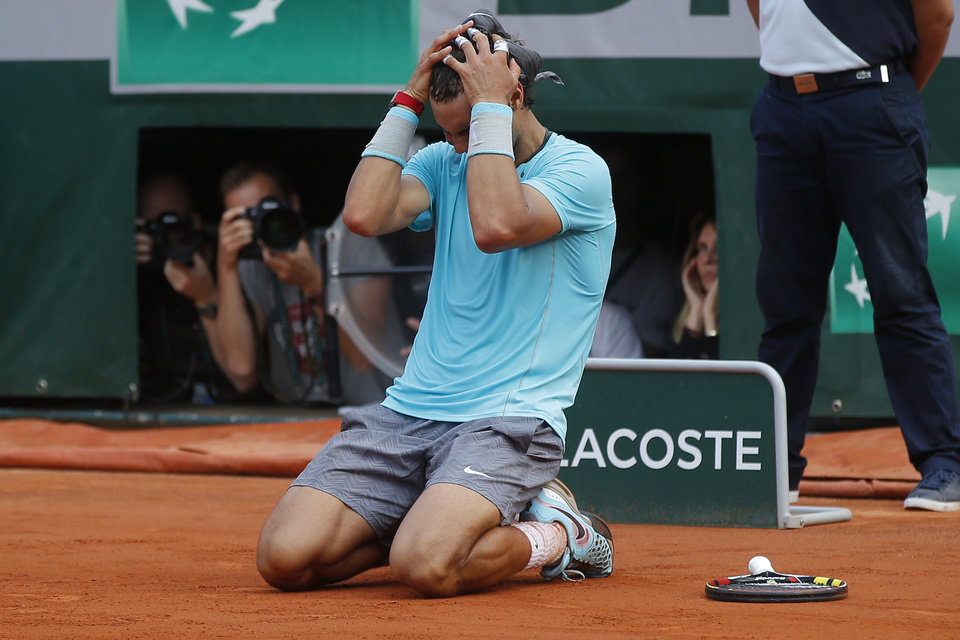 Photo - Spain's Rafael Nadal celebrates winning the final of the French Open tennis tournament against Serbia's Novak Djokovic at the Roland Garros stadium, in Paris, France, Sunday, June 8, 2014. Nadal won in four sets 3-6, 7-5, 6-2, 6-4. (AP Photo/Michel Euler)