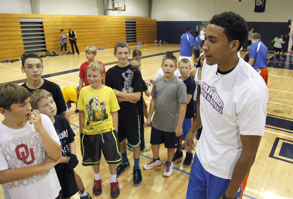 Photo - Thunder forward Josh Huestis interacts with students as he visits this week's Thunder youth basketball clinic at Casady School.  Photo by Paul Hellstern, The Oklahoman  PAUL HELLSTERN