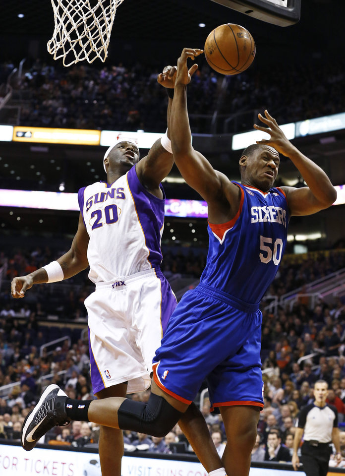 Phoenix Suns' Jermaine O'Neal (20) blocks the shot of Philadelphia 76ers' Lavoy Allen (50) during the first half of an NBA basketball game on Wednesday, Jan. 2, 2013, in Phoenix. (AP Photo/Ross D. Franklin)