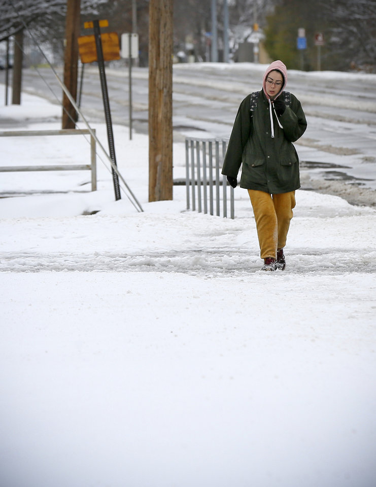Photo - A pedestrian walks south on Pennsylvania Ave. near NW Britton Rd. after a snow storm in The Village, Wednesday, Feb. 5, 2020. [Nate Billings/The Oklahoman]