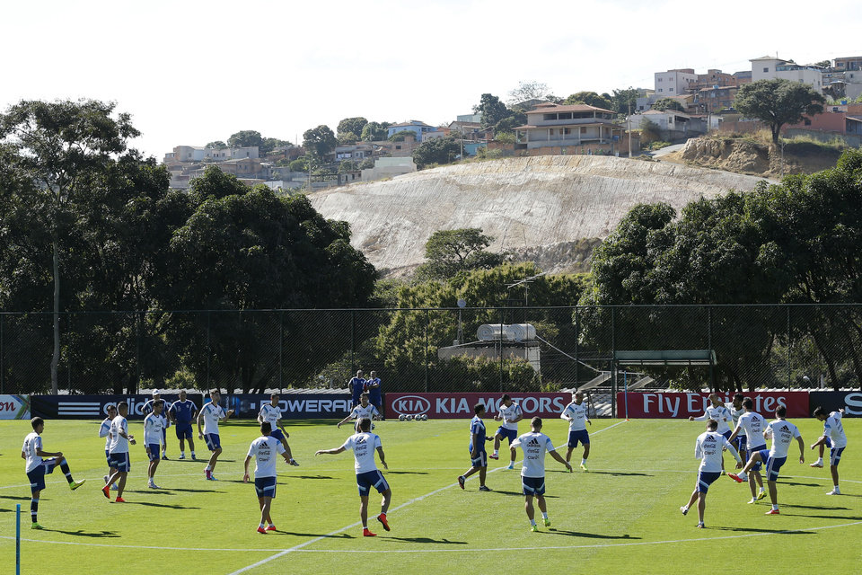 Photo - Argentina's team warms up during a training session at Cidade do Galo training ground in Vespasiano, near Belo Horizonte, Brazil, Friday, June, 13, 2014. Argentina will play in group F of the Brazil 2014 soccer World Cup. (AP Photo/Victor R. Caivano)