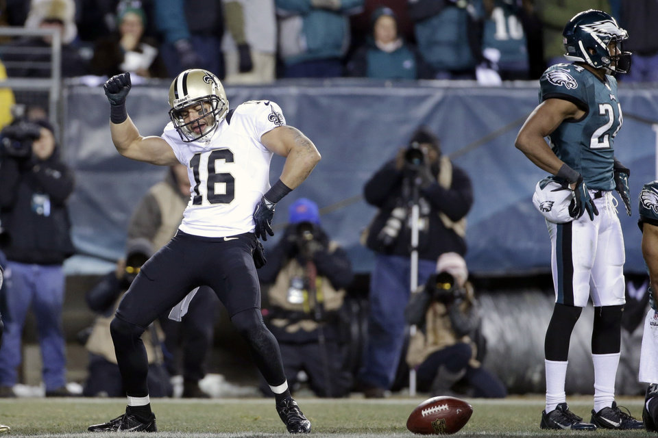 Photo - New Orleans Saints' Lance Moore (16) celebrates after scoring a touchdown during the second half of an NFL wild-card playoff football game against the Philadelphia Eagles, Saturday, Jan. 4, 2014, in Philadelphia. (AP Photo/Matt Rourke)