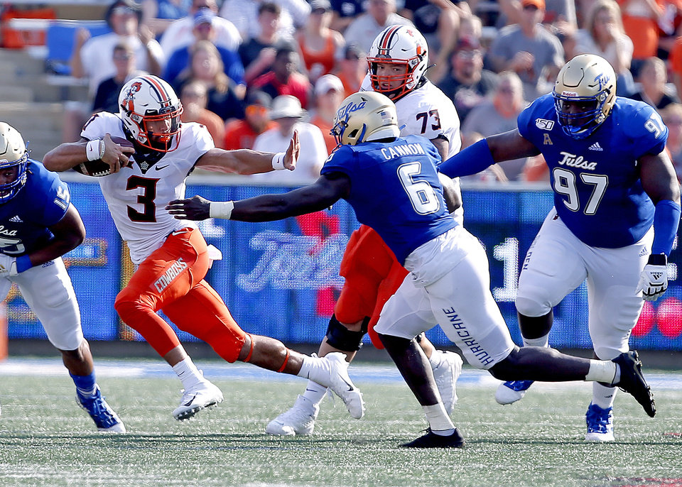 Photo - Oklahoma State's Spencer Sanders (3) looks to get by Tulsa's Diamon Cannon (6) in the third quarter during a college football game between the Oklahoma State University Cowboys (OSU) and the University of Tulsa Golden Hurricane (TU) at H.A. Chapman Stadium in Tulsa, Okla., Saturday, Sept. 14, 2019. [Sarah Phipps/The Oklahoman]