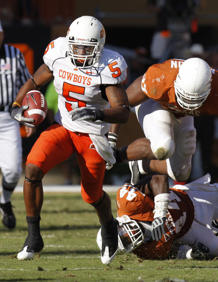 Photo - COLLEGE FOOTBALL: Keith Toston leaves Texas' players tripping over themselves as Oklahoma State University (OSU) plays the University of Texas (UT) at Darrell K. Royal-Texas Memorial Stadium at Joe Jamail Field in Austin, Texas on Saturday October 25, 2008. By Doug Hoke, The Oklahoman  ORG XMIT: KOD
