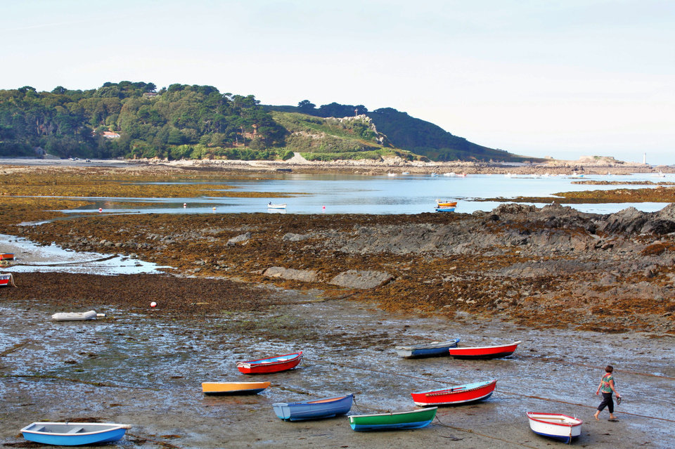 Photo - This Sept. 3, 2013 photo shows brightly colored rowboats beached in Guernsey, one of the Channel Islands in the waters between England and France. The scene is one of many that can be enjoyed on a bike tour of the area offered while in port on a cruise. (AP Photo/Charmaine Noronha)
