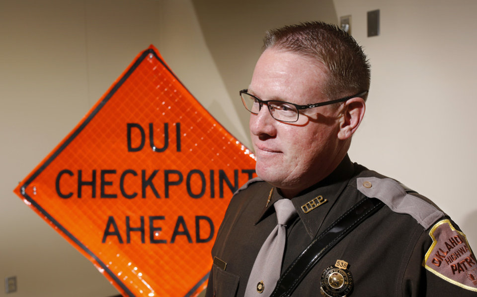 Photo -  Trooper Chris Liles is an expert in drug recognition. In his duties with the Oklahoma Highway Patrol, Liles' duties include recognizing the signs of a drug-impaired driver. He is photographed on Tuesday, Dec. 6, 2016, at Troop A headquarters in southwest Oklahoma City. [Photo by Jim Beckel, The Oklahoman]