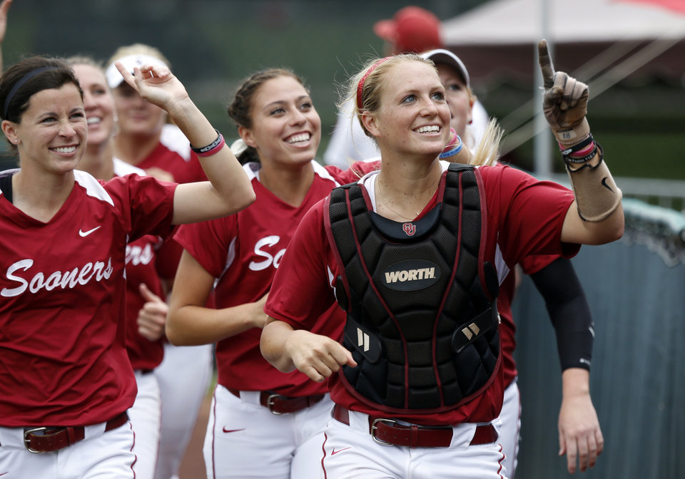 Photo - Catcher Jessica Shults and teammates make a victory lap and celebrate with the crowd after the NCAA Super Regional softball game as the University of Oklahoma (OU) Sooners defeat Texas A&M 8-0 at Marita Hines Field on Saturday, May 25, 2013 in Norman, Okla. to advance to the College World Series.  Photo by Steve Sisney, The Oklahoman