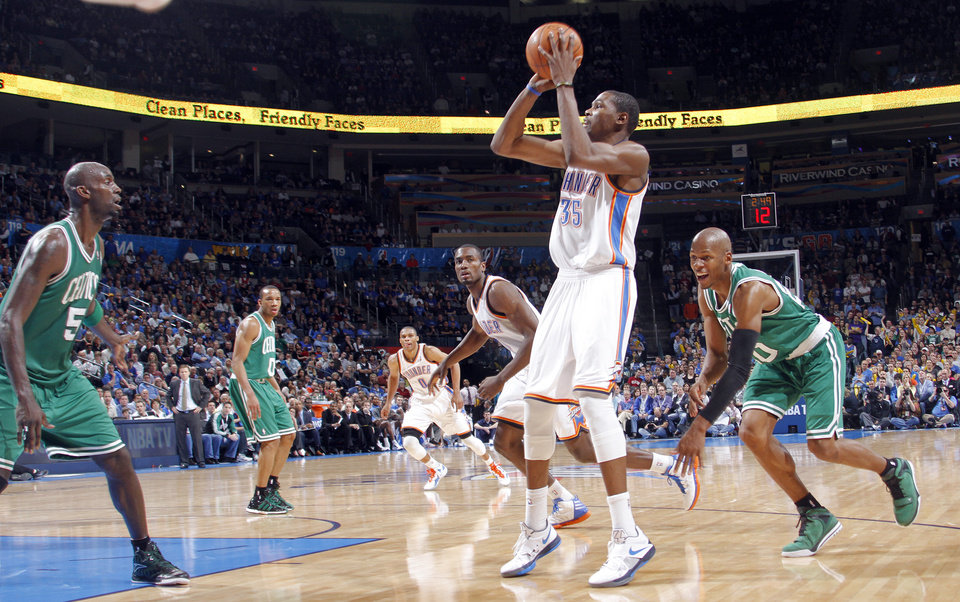 Oklahoma City Thunder small forward Kevin Durant (35) takes a shot past Boston Celtics shooting guard Ray Allen (20) during the NBA basketball game between the Oklahoma City Thunder and the Boston Celtics at the Chesapeake Energy Arena on Wednesday, Feb. 22, 2012 in Oklahoma City, Okla.  Photo by Chris Landsberger, The Oklahoman