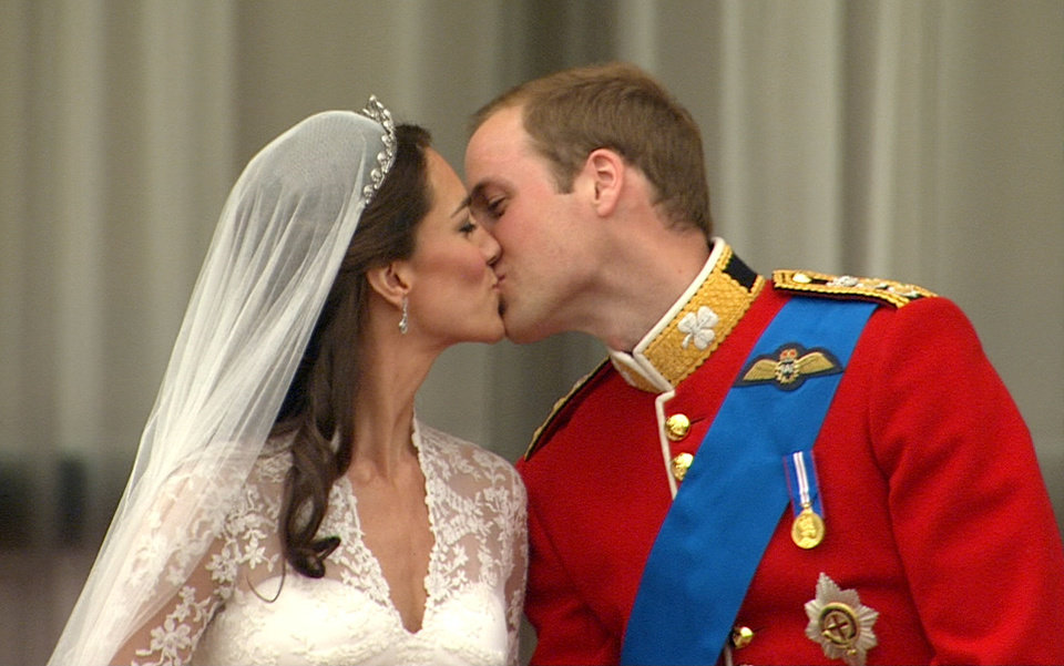 Photo - In this image taken from video, Britain's Prince William, right, kisses his wife, Kate, the Dutchess of Cambridge, from the balcony of Buckingham Palace after  the Royal Wedding in London on Friday, April, 29, 2011. (AP Photo/APTN) EDITORIAL USE ONLY NO ARCHIVE PHOTO TO BE USED SOLELY TO ILLUSTRATE NEWS REPORTING OR COMMENTARY ON THE FACTS OR EVENTS DEPICTED IN THIS IMAGE ORG XMIT: RWVM311