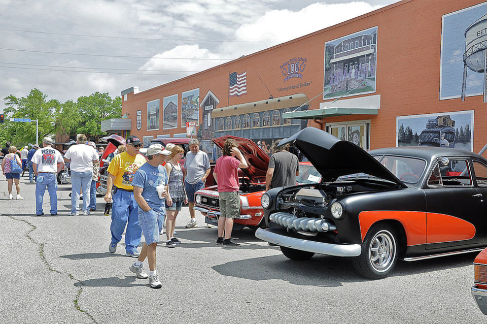 Visitors check out the car show during the Bethany 66 Festival on Saturday. PHOTO BY M. TIM BLAKE, FOR THE OKLAHOMAN <strong></strong>