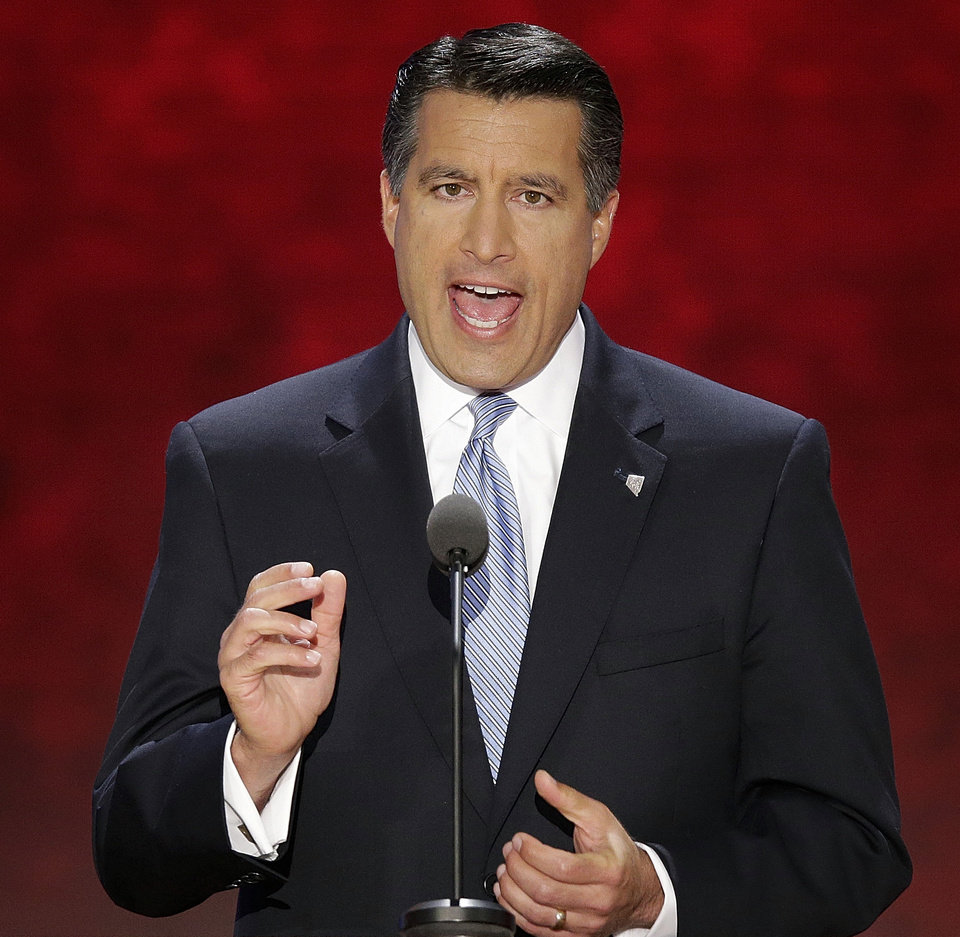 FILE - In this Aug. 28, 2012, photo, Nevada Gov. Brian Sandoval addresses the Republican National Convention in Tampa, Fla.  Sandoval heads into the 2013 legislation session with a pledge to keep the lid on state spending while facing soaring costs for social services, expanding Medicaid and recommending more tax breaks for businesses.  (AP Photo/J. Scott Applewhite)