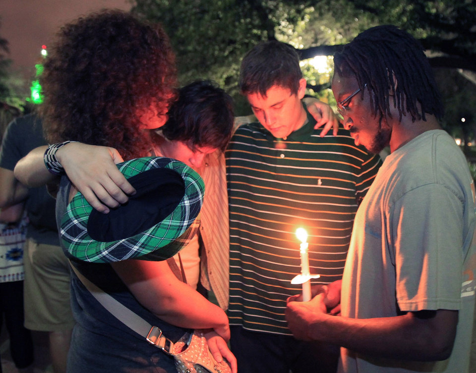 Baylor University student's hold a candle light vigil outside Waco Hall for the victim's of the West fertilizer plant explosion, Wednesday, April 17, 2013. (AP Photo/Waco Tribune Herald, Jerry Larson)