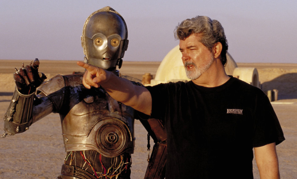 Photo -   ** FILE ** In this undated publicity photo released by Lucasfilm Ltd. & TM, director George Lucas directs actor Anthony Daniels, who plays the robot C-3PO, in