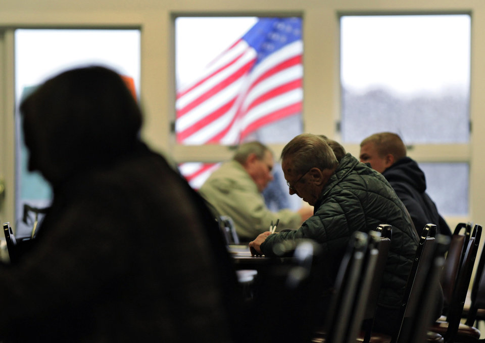 Photo -   Voters find room at a table to fill out their ballots at the Church of the Holy Spirit in St. Cloud, Minn., Tuesday, Nov. 6, 2012. (AP Photo/St. Cloud Times, Jason Wachter)