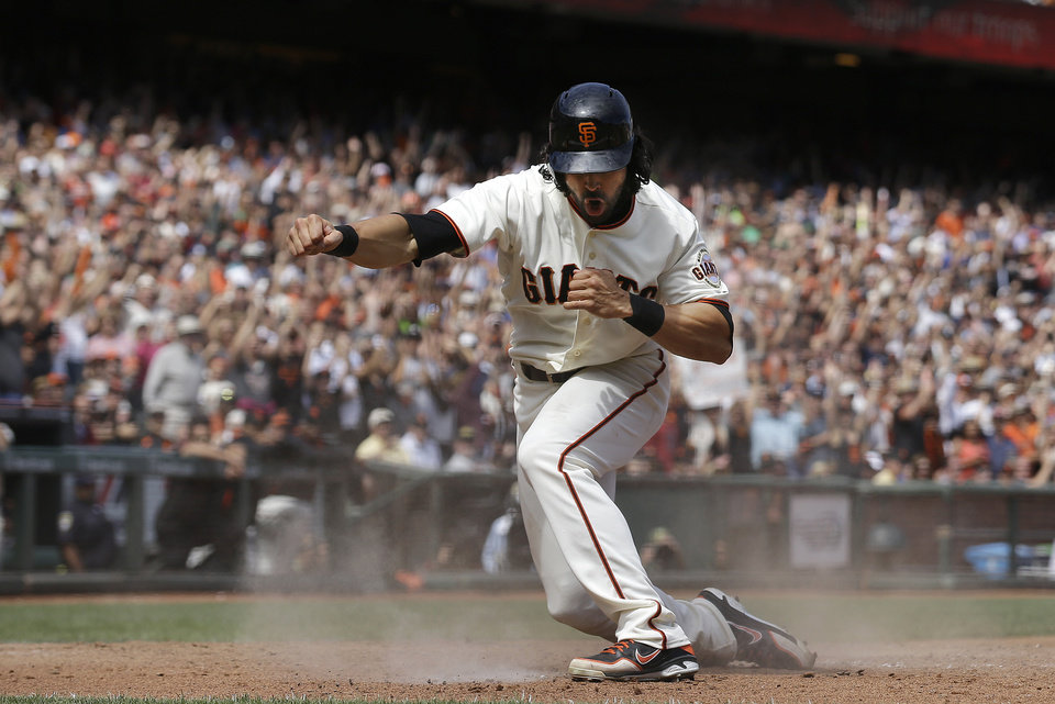 Photo - San Francisco Giants' Angel Pagan celebrates after scoring against the Chicago White Sox during the seventh inning of a baseball game in San Francisco, Wednesday, Aug. 13, 2014. (AP Photo/Jeff Chiu)