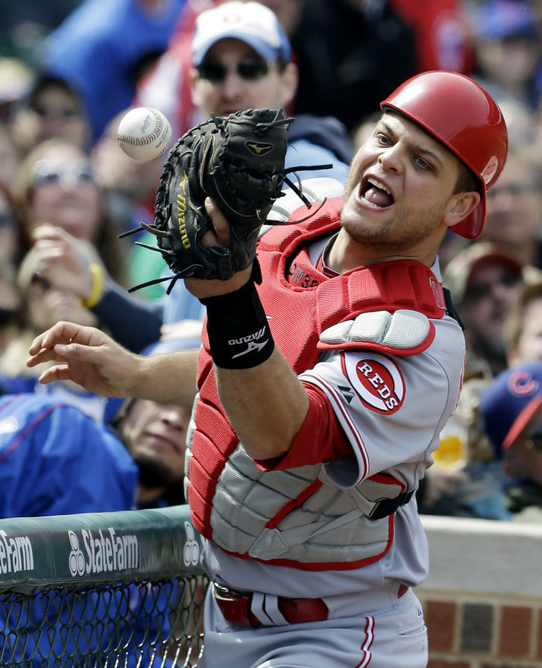 Photo - Cincinnati Reds catcher Devin Mesoraco can't make the catch on a foul hit by Chicago Cubs' Starlin Castro during the first inning of a baseball game in Chicago, Saturday, April 19, 2014. (AP Photo/Nam Y. Huh)