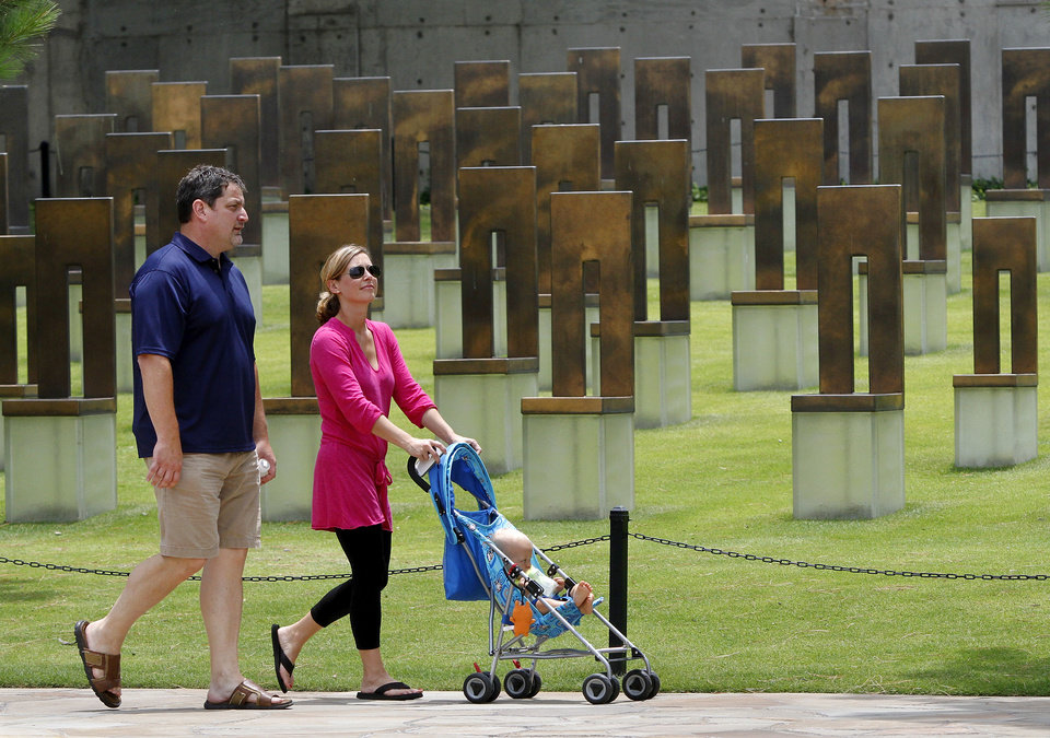 Photo - Harold and Timarra Byfield  of Oklahoma City, walk past the field of chairs with their 11 month-old son, Blake,  while visiting  the Oklahoma City National Memorial &  Museum,   Saturday afternoon, June 16,  2012.    Photo by Jim Beckel, The Oklahoman