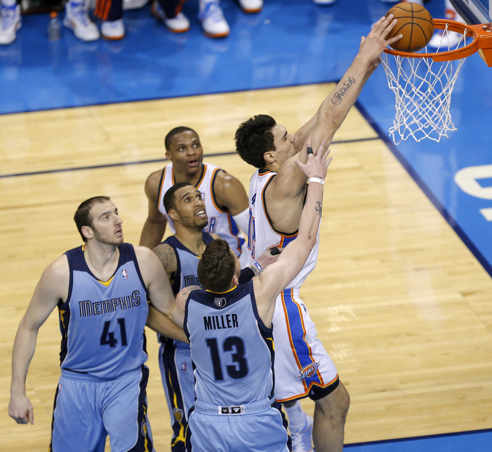 Photo - Oklahoma City's Steven Adams (12) dunks during Game 7 in the first round of the NBA playoffs between the Oklahoma City Thunder and the Memphis Grizzlies at Chesapeake Energy Arena in Oklahoma City, Saturday, May 3, 2014. Photo by Sarah Phipps, The Oklahoman