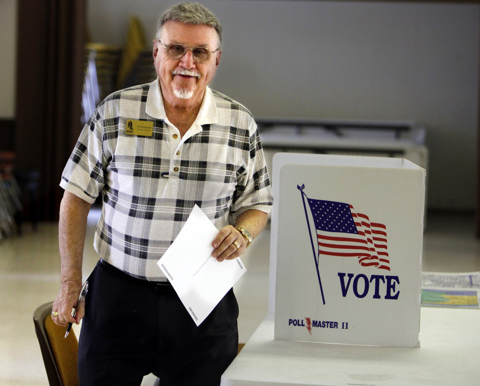 "Cal Brannon, member of ""A Community Working Together,"" a citizens committee hoping to encorage passage of a $42 million bond package, casts his vote at precinct 19 on Tuesday, Aug. 28, 2012, in Norman, Okla.  Photo by Steve Sisney, The Oklahoman"