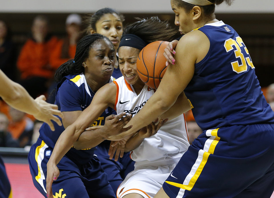 Oklahoma State's Tiffany Bias (3) gets stuck between West Virginia's Linda Stepney (22) and Ayana Dunning (33) during a women's college basketball game between Oklahoma State and West Virginia at Gallagher-Iba Arena in Stillwater, Okla.,  Tuesday, Jan. 29, 2013. West Virginia won 67-61. Photo by Bryan Terry, The Oklahoman