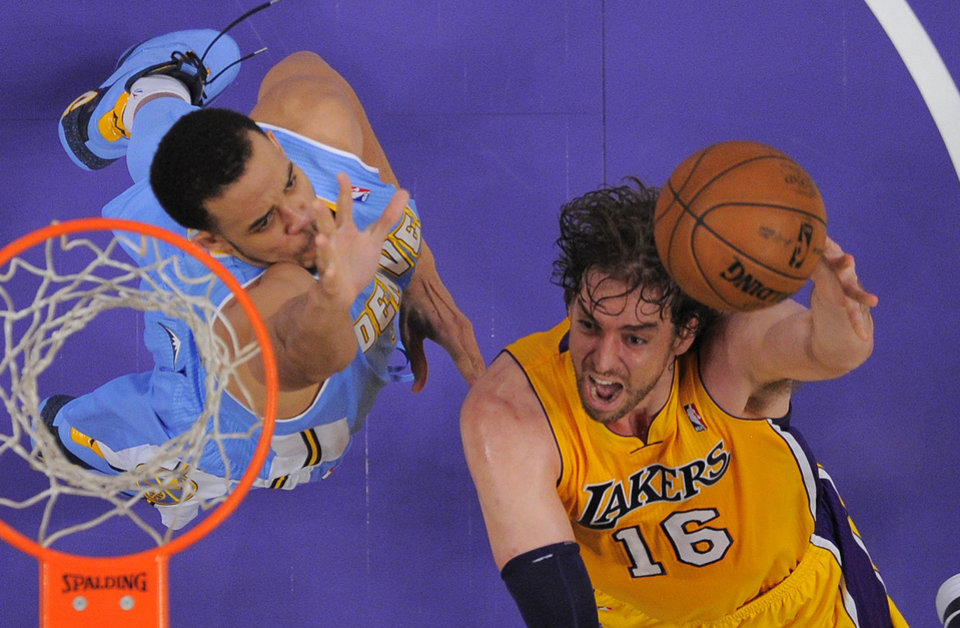 Los Angeles Lakers forward Pau Gasol, right, of Spain, puts up a shot as Denver Nuggets center JaVale McGee defends during the second half of their NBA basketball game, Friday, Nov. 30, 2012, in Los Angeles, Calif. The Lakers won 122-103. (AP Photo/Mark J. Terrill)