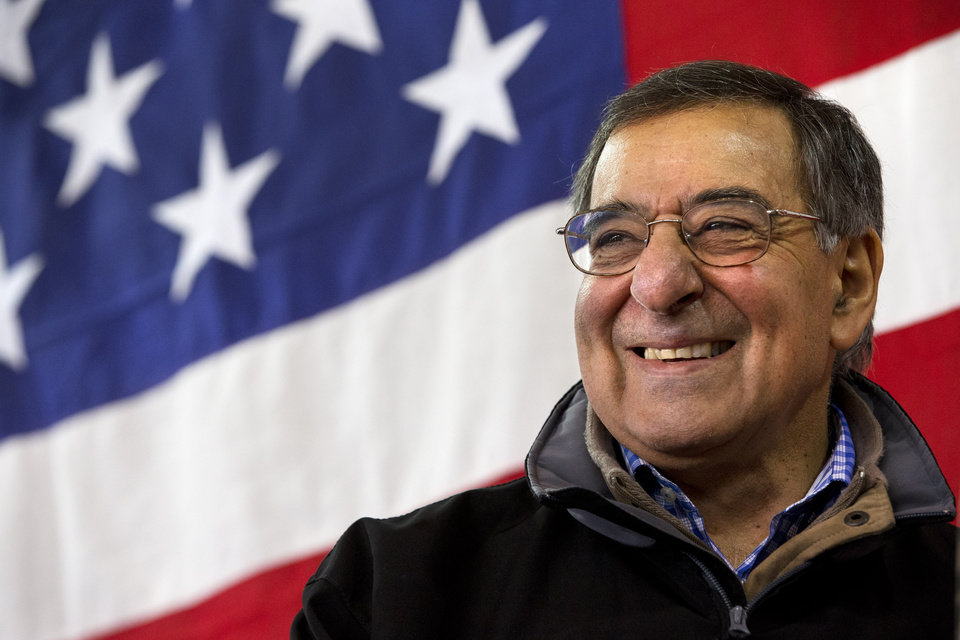 Photo - Defense Secretary Leon Panetta smiles as he speaks to the 173rd Airborne Brigate Combat Team at U.S. Army Garrison in Vicenza, Italy, Thursday, Jan. 17, 2013. Panetta is in Italy as part of a weeklong swing across Europe, meeting with defense ministers to talk about ongoing conflicts in Afghanistan and Mali. This is expected to be Panetta's last overseas trip as Pentagon chief, as he long has planned to step down once his replacement is confirmed. (AP Photo/Jacquelyn Martin)