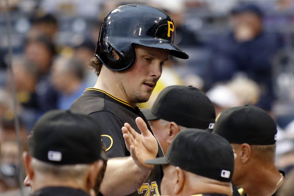 Photo - Pittsburgh Pirates' Travis Snider is greeted by teammates as he heads to the dugout after scoring on a hit by Jayson Nix in the first inning of the baseball game on Monday, Aug. 11, 2014, in Pittsburgh. (AP Photo/Keith Srakocic)