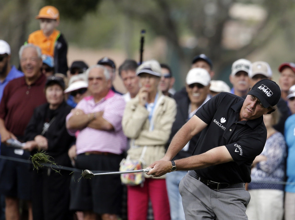 Photo - Phil Mickelson hits onto the 16th green during the second round of the Honda Classic golf tournament, Friday, Feb. 28, 2014, in Palm Beach Gardens, Fla. (AP Photo/Lynne Sladky)