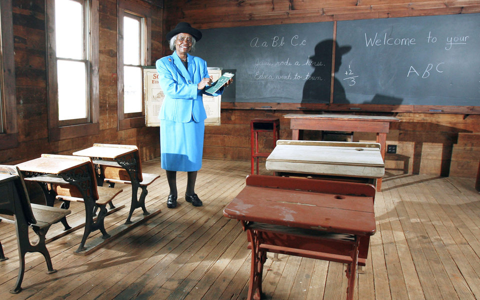 Photo - Loretta Jackson stands inside a one-room schoolhouse called the Verden Separate School in Chickasha.  Photo by Steve Sisney, The Oklahoman