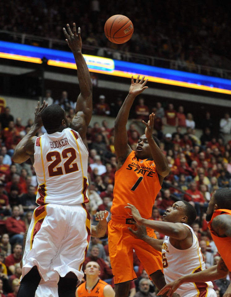 Oklahoma State\'s Kirby Gardner takes a shot over Iowa State\'s Anthony Booker during 1st half at Hilton Coliseum Wednesday, March 6, 2013, in Ames, Iowa. Photo by Nirmalendu Majumdar/Ames Tribune