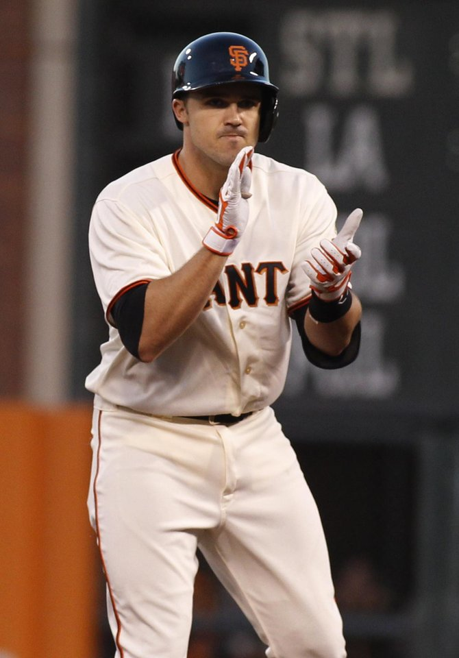 Photo - San Francisco Giants' Adam Duvall claps his hands after hitting a double against the Cincinnati Reds during the fifth inning of a baseball game, Saturday, June 28, 2014, in San Francisco.  (AP Photo/George Nikitin)