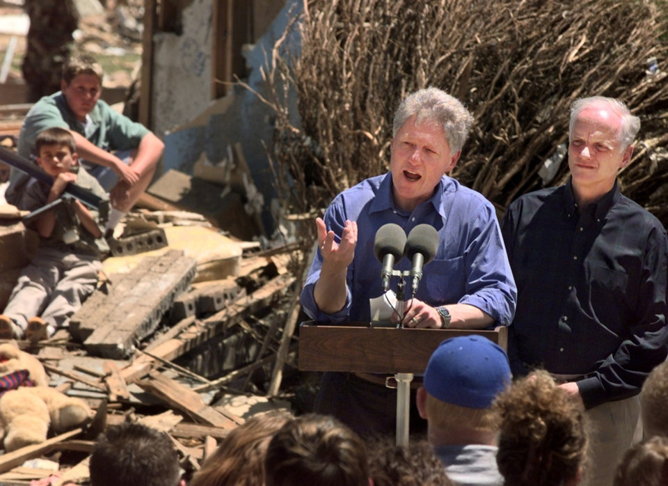 Tornado damage tour: President Bill Clinton addresses the residents of the Del Aire housing addition neighborhood with Gov. Frank Keating beside him.