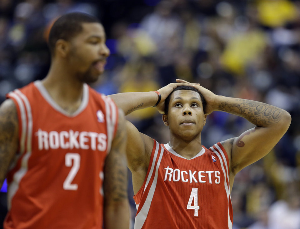 Photo - Houston Rockets' Greg Smith (4) looks up at the scoreboard during a timeout in the second half of an NBA basketball game against the Indiana Pacers Friday, Jan. 18, 2013, in Indianapolis. The Pacers defeated the Rockets 104-93. (AP Photo/Darron Cummings)